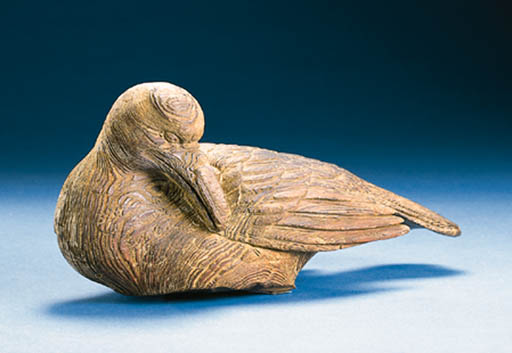 A CARVED SLEEPING BIRD