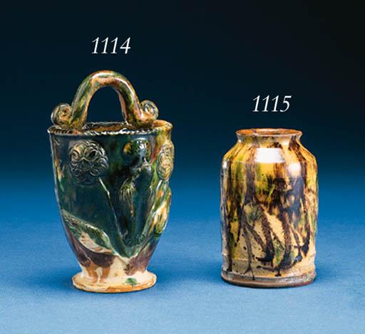A GLAZED REDWARE TOBACCO JAR