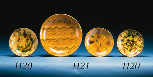 A PAIR OF SLIP-WASHED PLATES