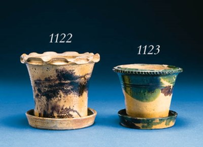 A GLAZED REDWARE FLOWERPOT AND