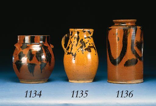 A GLAZED REDWARE TWO-HANDLED C