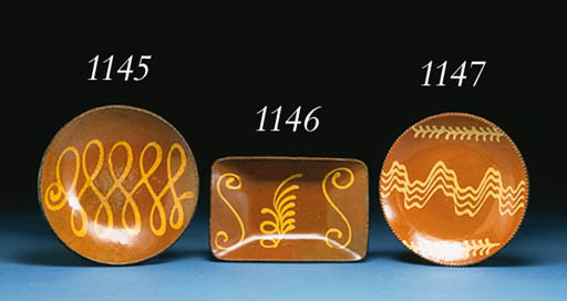 A SLIP-DECORATED REDWARE DISH