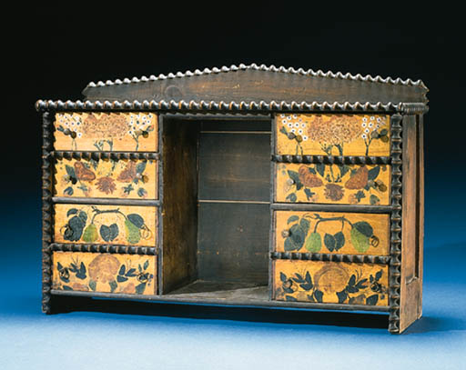 A PAINT-DECORATED STAND WITH D