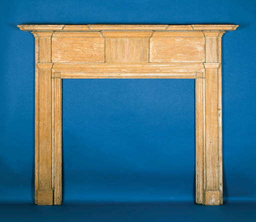 A CARVED WOODEN MANTLE