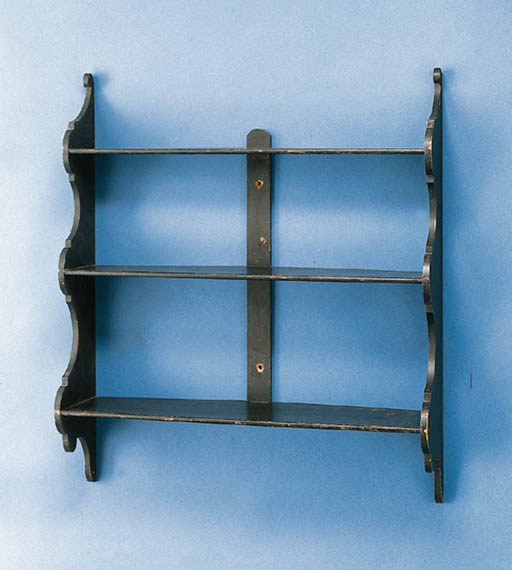 A WOODEN HANGING SHELF