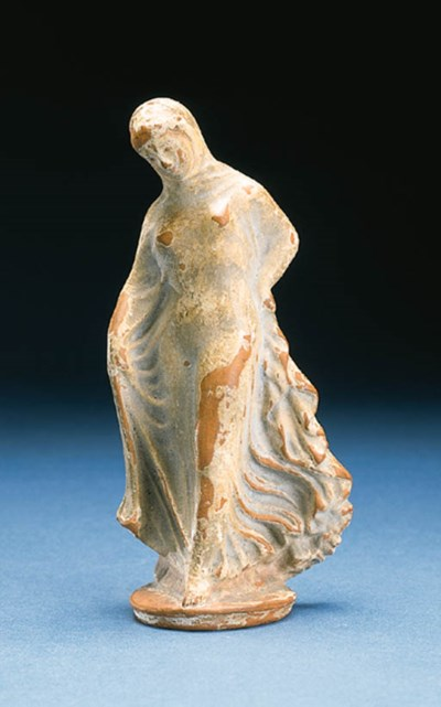 A SLIP-WASHED REDWARE FIGURE