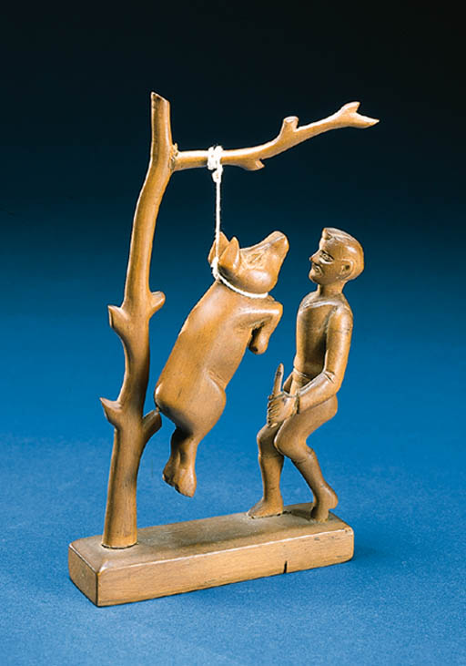 A CARVED WOODEN SCULPTURE OF A