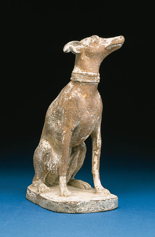A GLAZED REDWARE FIGURE OF A D