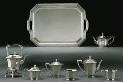 A SEVEN-PIECE SILVER TEA AND C