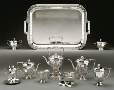 A SILVER NINE-PIECE TEA AND CO