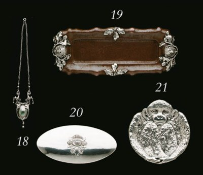 A MOTHER-OF-PEARL SET SILVER N