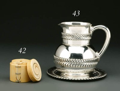 A SILVER WATER PITCHER WITH ST