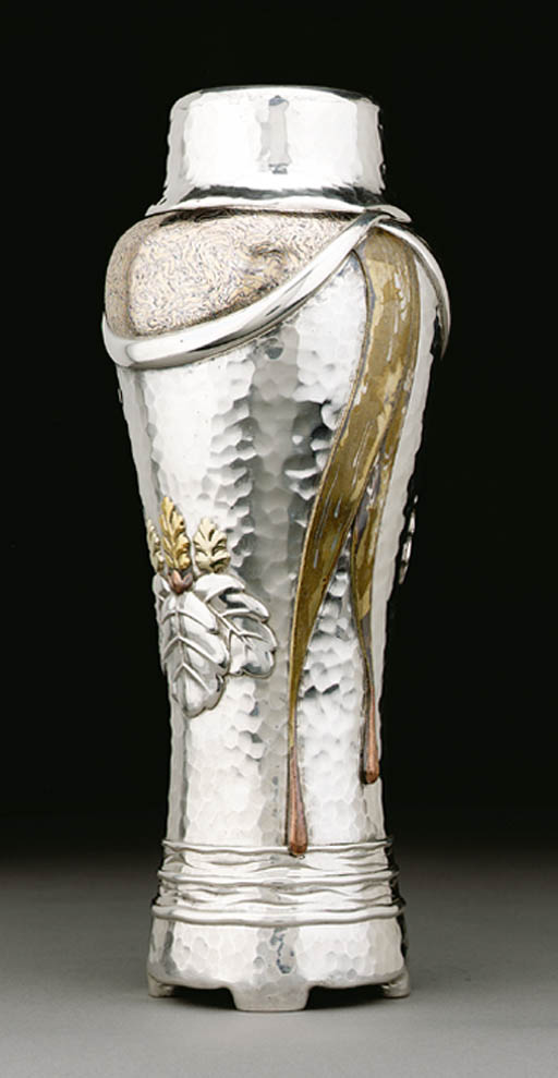 A SILVER AND MIXED-METAL VASE