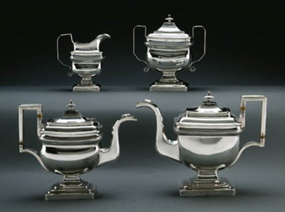 A SILVER FOUR-PIECE TEA AND CO