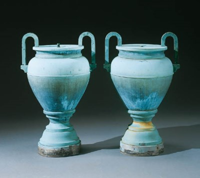 A PAIR OF MOLDED COPPER URNS