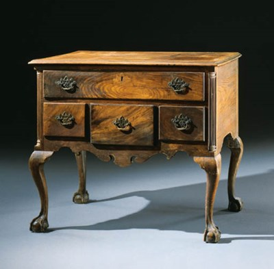 A CHIPPENDALE CARVED WALNUT DR