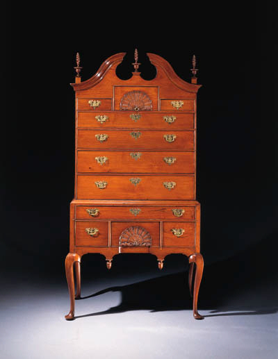 A CHIPPENDALE CARVED WALNUT HI