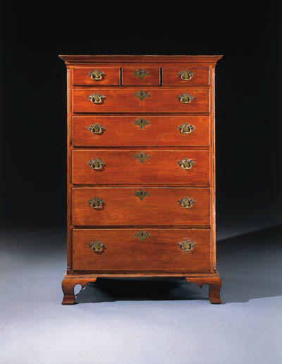A CHIPPENDALE WALNUT TALL CHES