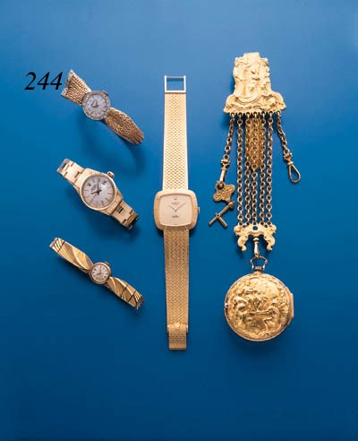 ROLEX.  A LADY'S 18K GOLD AND