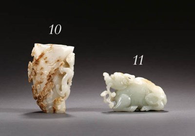 A WELL-CARVED WHITE JADE FIGUR
