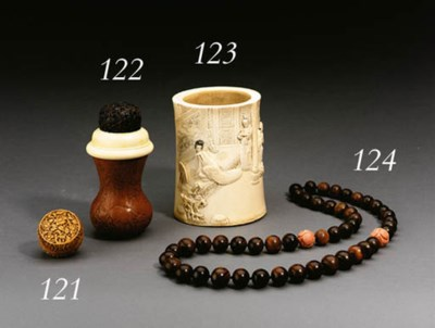 **A SMALL WELL-CARVED IVORY CI
