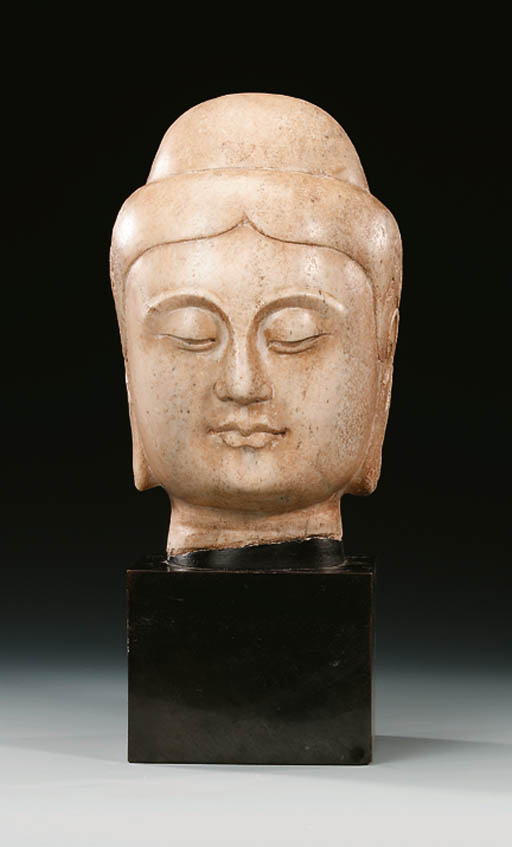 A WELL-CARVED WHITE MARBLE HEA