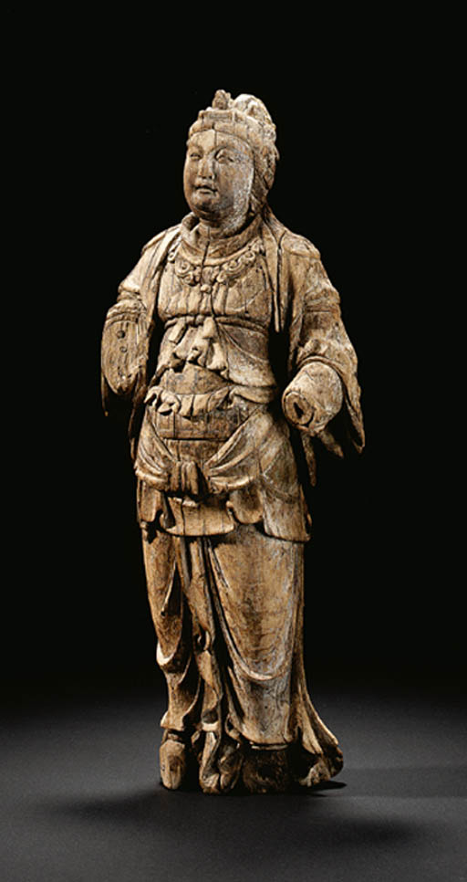 A WELL-CARVED WOOD FIGURE OF A