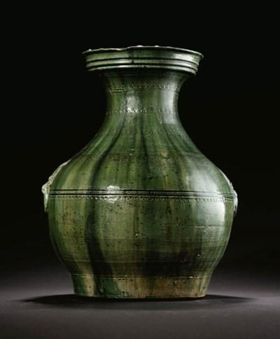 A GREEN-GLAZED RED POTTERY JAR