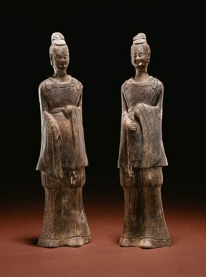 A PAIR OF GREY POTTERY FIGURES