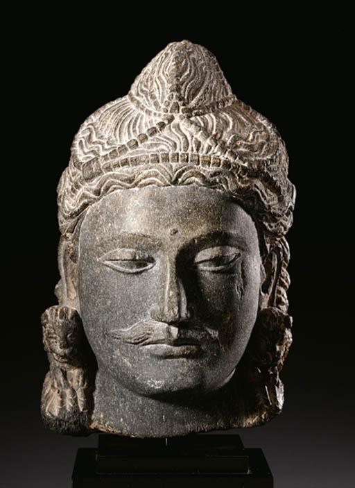 A gray schist head of a Bodhis