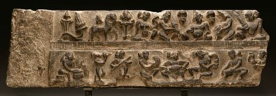 A stone lintel with dancers