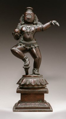 A bronze figure of Krishna
