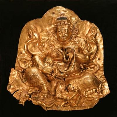 A gilt copper repouss plaque o