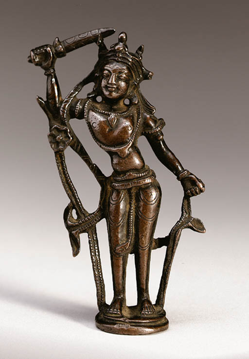 A small bronze figure of Manju