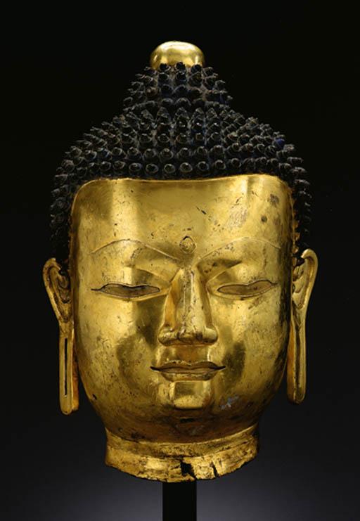A large bronze head of Buddha