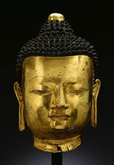 A large bronze head of Buddha