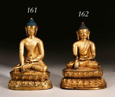A gilt bronze figure of a medi