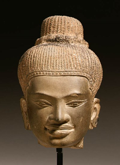 A stone head of a female deity