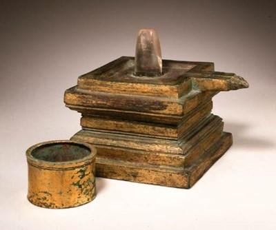 A quartz linga and gilt bronze