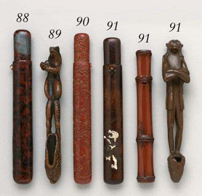 A CARVED LACQUER PIPECASE
