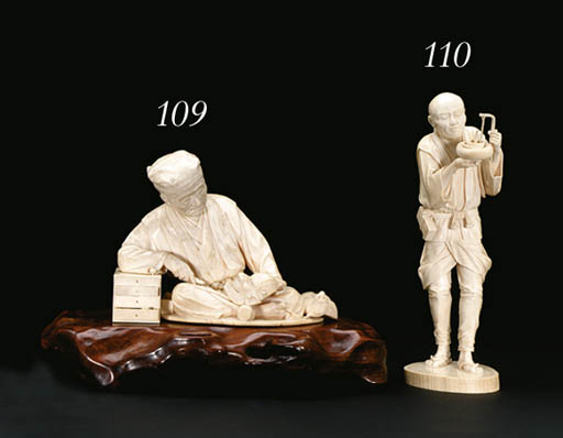 AN IVORY FIGURE OF A MAN**