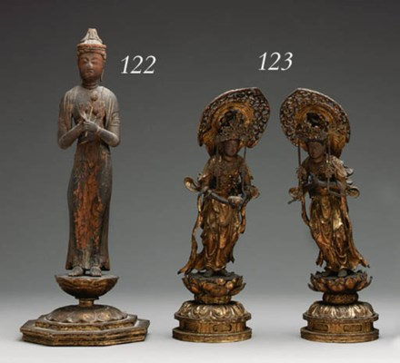 A WOOD STANDING FIGURE OF SHO-