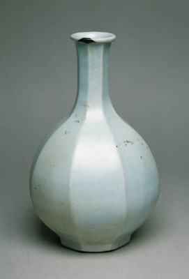 A FACETED WHITE PORCELAIN BOTT