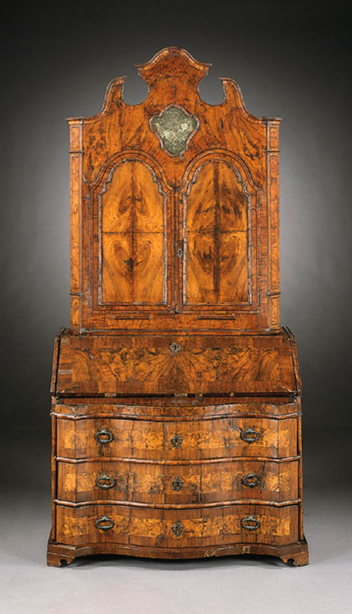 AN ITALIAN BAROQUE WALNUT BURE