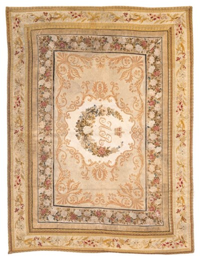 AN ENGLISH PETIT-POINT RUG