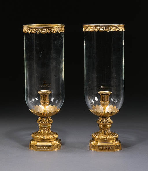 A PAIR OF LOUIS XVI STYLE ORMOLU AND GLASS PHOTOPHORES
