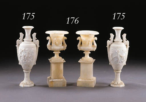 A PAIR OF ITALIAN NEOCLASSIC STYLE WHITE MARBLE URNS