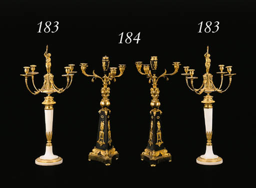A PAIR OF CONTINENTAL NEOCLASSIC ORMOLU AND WHITE MARBLE FOUR-LIGHT CANDELABRA