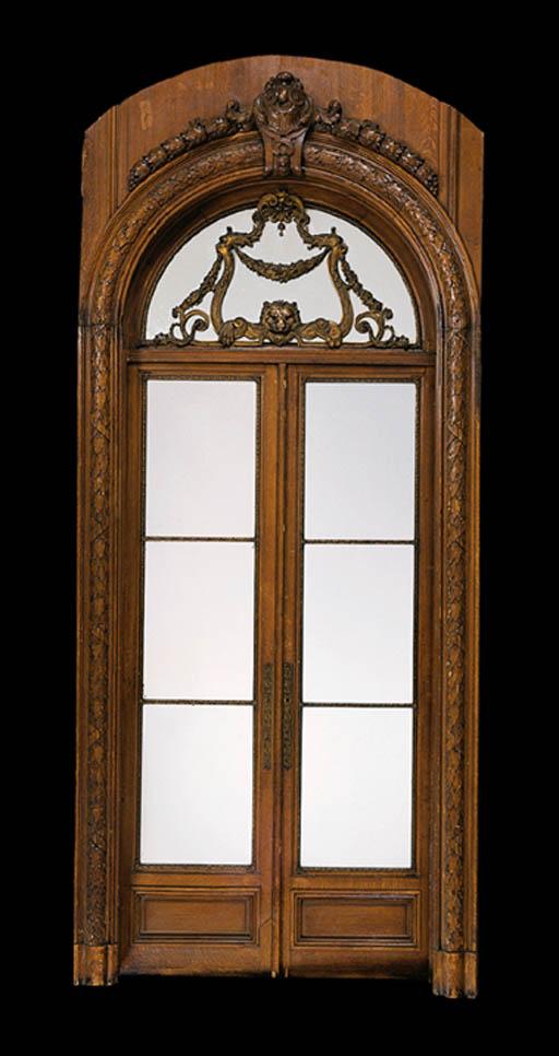 A SET OF FOUR FRENCH ORMOLU-MOUNTED OAK DOUBLE DOORS