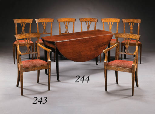 A SET OF EIGHT ITALIAN NEOCLASSIC WALNUT AND MARQUETRY DINING CHAIRS